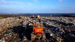City Dump. The Bulldozer Compacts the Garbage on the Landfill. Wastes of Human Life