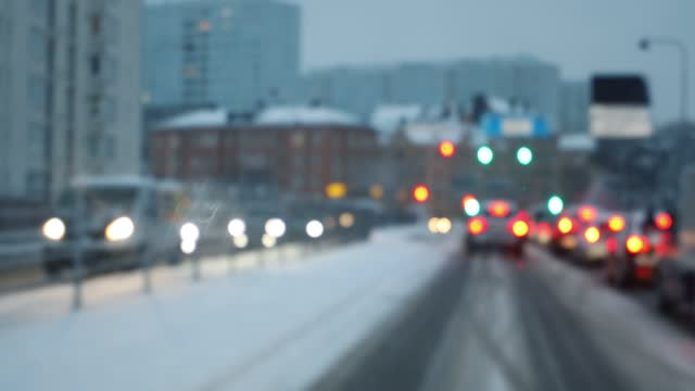 city evening traffic in winter viewed from car - car point of view stock videos & royalty-free footage