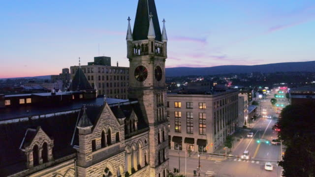 city hall and downtown district of scranton in the night. pennsylvania, usa. aerial drone video with the descending camera motion. - small town america stock videos & royalty-free footage