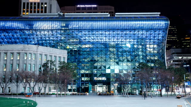 city hall and public plaza at night in seoul - government building stock videos and b-roll footage