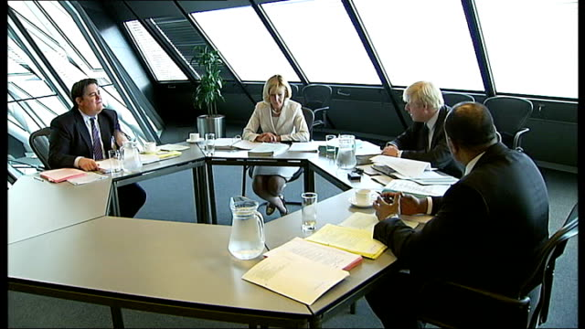 int boris johnson mp seated at roundtable meeting with members of forensic audit panel patience wheatcroft stephen greenhalgh and patrick frederick - audit stock videos and b-roll footage