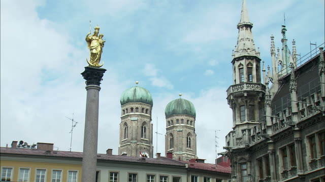 MS City hall tower and St. Mary's Column with Frauenkirche towers in background, Marienplatz, Munich, Bavaria, Germany