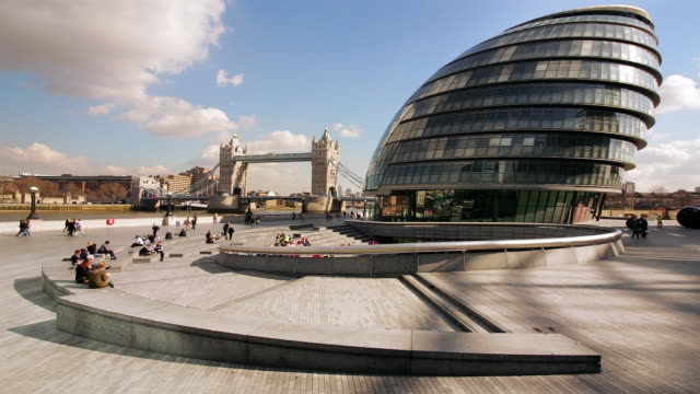 ms, t/l, city hall with tower bridge in background, london, england - gla building stock videos & royalty-free footage