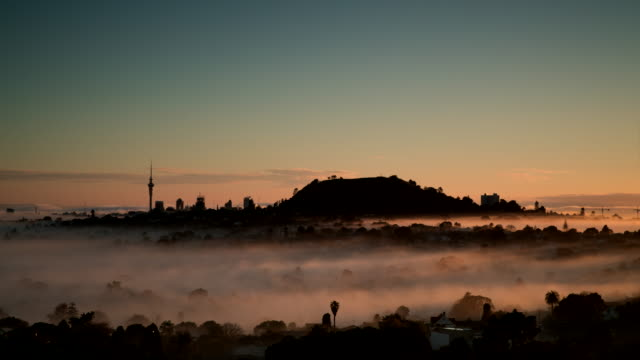 city in fog - sunrise dawn stock videos & royalty-free footage