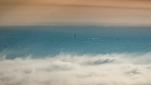 City in the mist and movement of cloud , time-lapse , 4k(UHD)