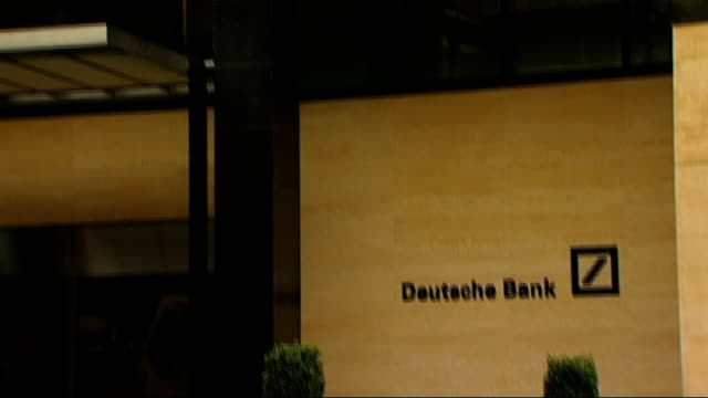 city investment bank employee suspended after taunting campaigners protesting at nhs cuts entrance to deutsche bank offices tilt up - deutsche bank stock videos & royalty-free footage