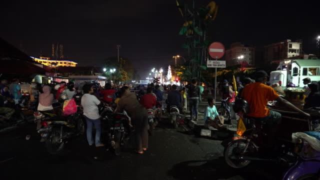 city life and traffic on malioboro street - indonesia street stock videos & royalty-free footage