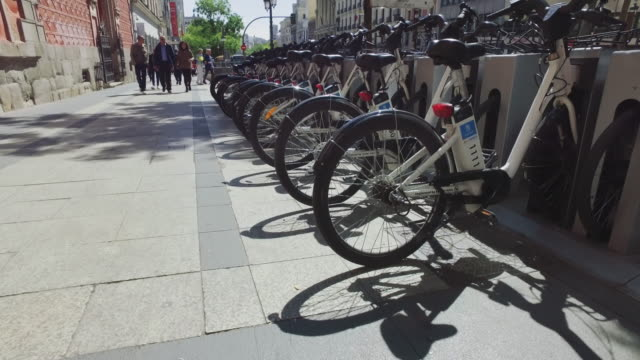 city life in madrid, spain: bicycle sharing - madrid stock videos & royalty-free footage