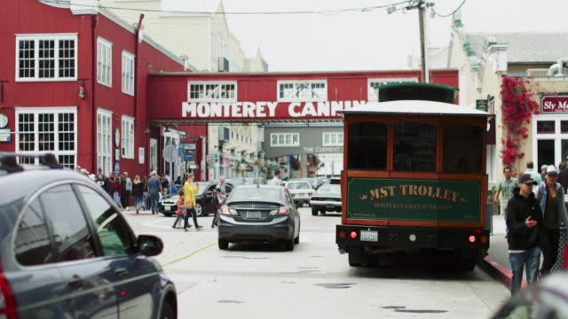 city life in monterey - trolleybus stock-videos und b-roll-filmmaterial