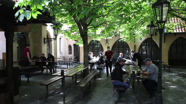 stockvideo's en b-roll-footage met city life scenes while czech republic reopens its cafe and restaurant terraces, in stare mesto, prague, czech republic, on monday, may 17, 2021. - stare mesto
