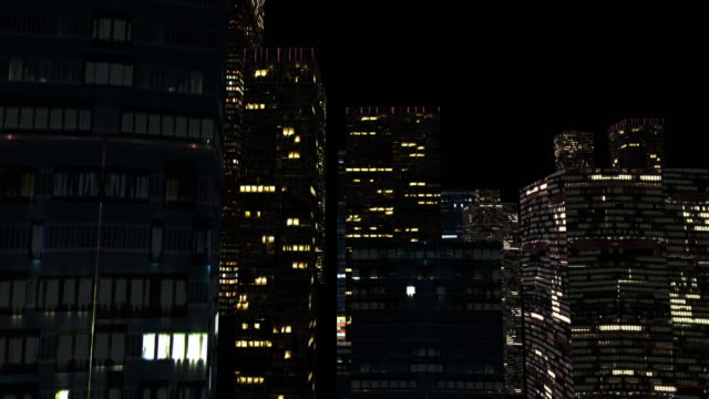 city lighting up at night - illuminated stock videos & royalty-free footage