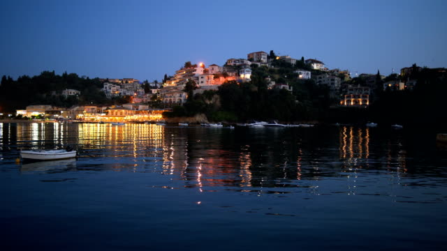 city lights at night from across the sea - greece stock videos & royalty-free footage