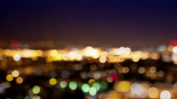 City lights blur at night. London