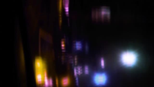 City lights flare, blur and streak.