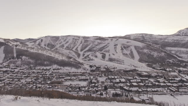 city lights glow as night falls on park city, utah. - park city utah video stock e b–roll