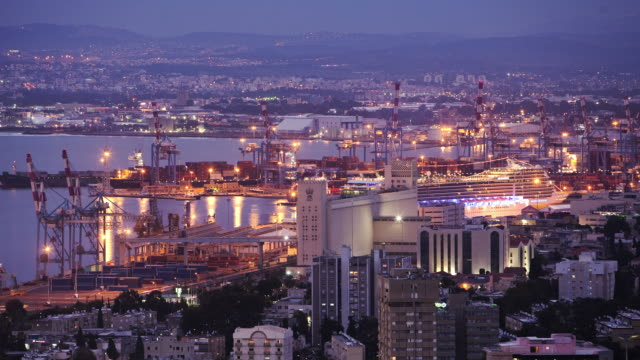 city lights glow bright over haifa's port. - haifa video stock e b–roll