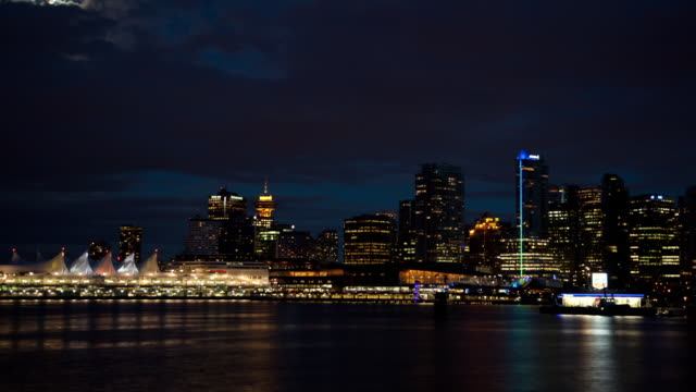 City lights illuminate Coal Harbor on Cortes Island at night.