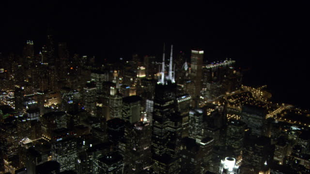 city lights illuminate downtown chicago at night. - willis tower stock videos & royalty-free footage