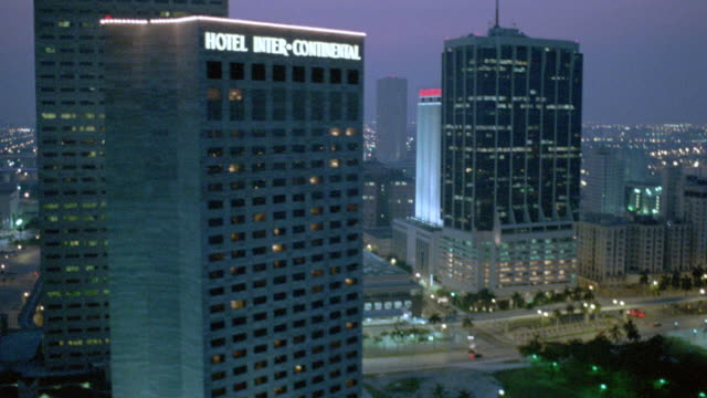 city lights illuminate miami's downtown at dusk. - intercontinental hotels group stock videos & royalty-free footage