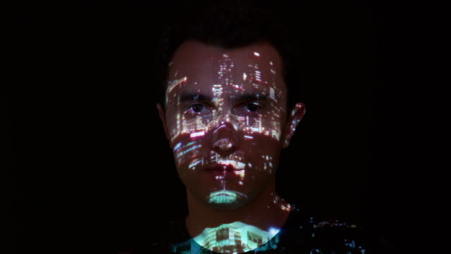 City lights projection on man's face
