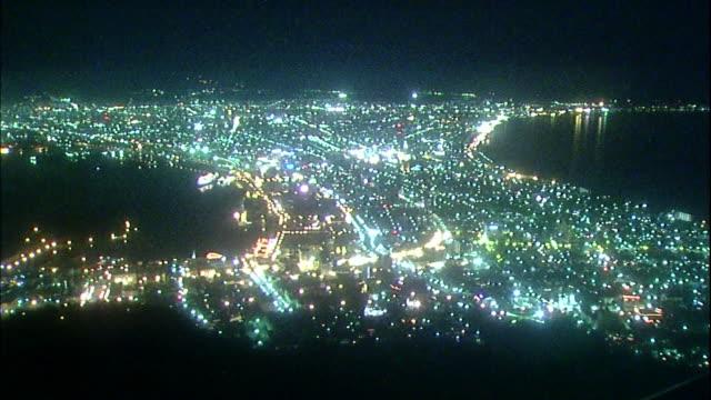 city lights shine in hakodate, japan. - hokkaido stock videos & royalty-free footage