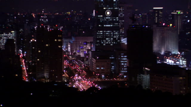 city lights twinkle in taipei, taiwan at night - taipei 101 stock videos & royalty-free footage