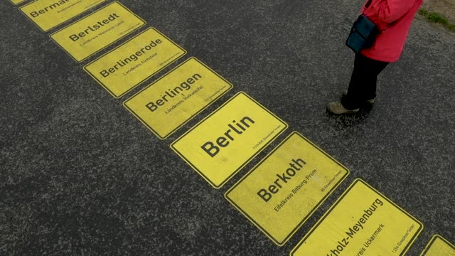 city limits signs, including berlin, form a walkway in the city center as part of celebrations to mark german unity day scheduled for wednesday on... - tag 1 stock-videos und b-roll-filmmaterial