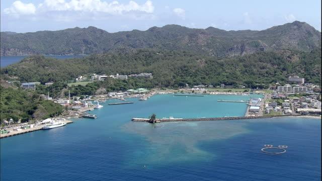 a city lines futami bay on chichijima island. - 湾点の映像素材/bロール