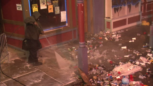 a city maintenance worker sprays litter from a sidewalk in new orleans. - littering stock videos & royalty-free footage