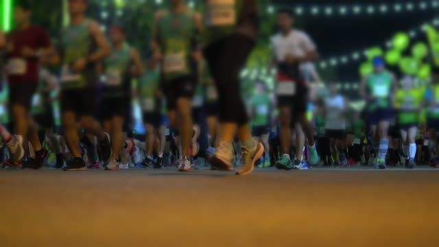 city marathon runners at race - marathon stock videos and b-roll footage