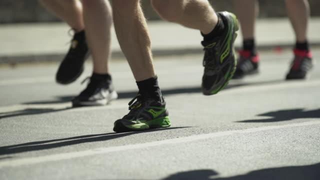 City Marathon Runners In The Back Lit (4K/UHD)