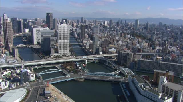 WS POV AERIAL City near river / Osaka, Japan