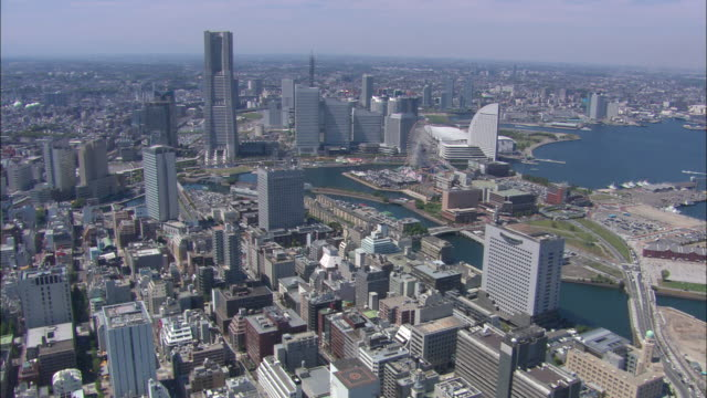 ws pov aerial city near river / yokohama, japan - yokohama stock videos and b-roll footage