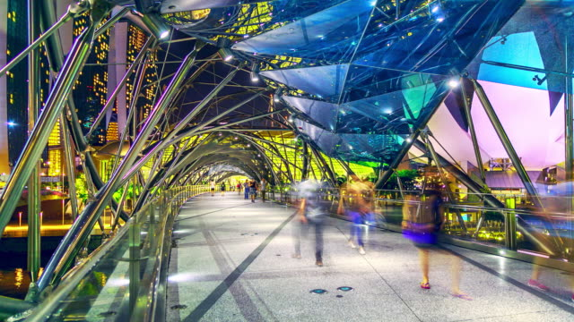 city night walk way on the bridge at singapore, time lapse. - helix bridge stock videos & royalty-free footage