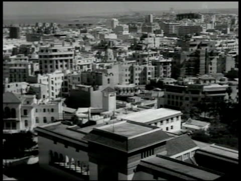 city of casablanca modern square building under construction midcentury modern office building highrise upscale urban prosperous prosperity thriving... - casablanca morocco stock videos & royalty-free footage