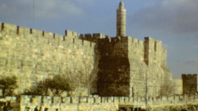 city of david citadel / jaffa gate / arab man getting a shoe shine / shouk entrance / jerusalem bagel / tourists exiting jaffa gate / jaffa gate on... - jaffa stock-videos und b-roll-filmmaterial