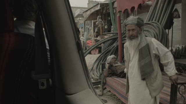 city of kabul - a man gets up to give give direction - kabul stock videos & royalty-free footage