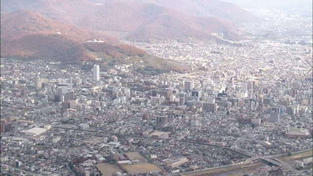 aerial, city of kofu, yamanashi, japan - 山梨県点の映像素材/bロール