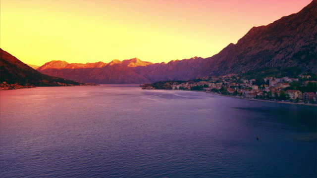 city of kotor, montenegro as the sun rises over the bay of kotor in the adriatic sea - bay of water stock videos & royalty-free footage