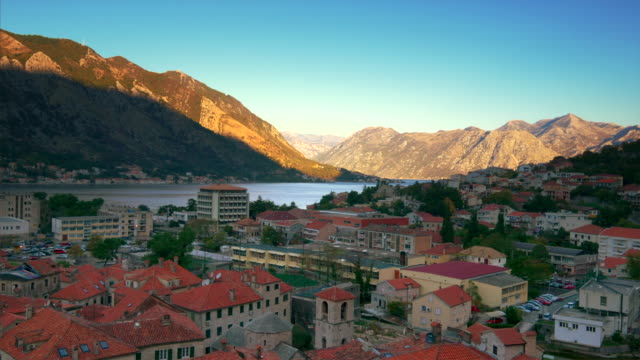 city of kotor, montenegro sits along the bay of kotor in the adriatic sea at sunrise - montenegro stock videos & royalty-free footage
