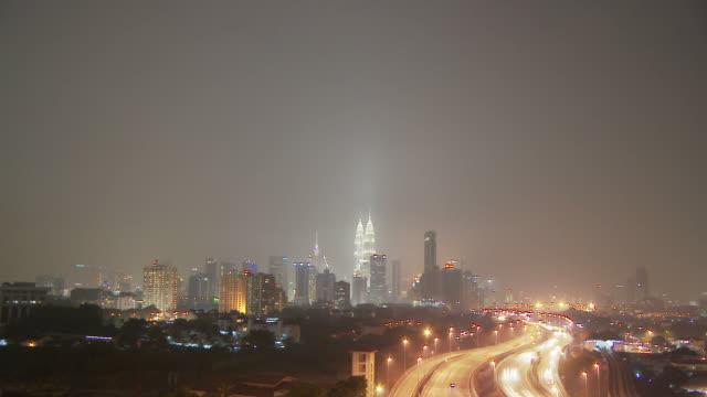city of kuala lumpur in lights, malaysia - menara kuala lumpur tower stock videos & royalty-free footage