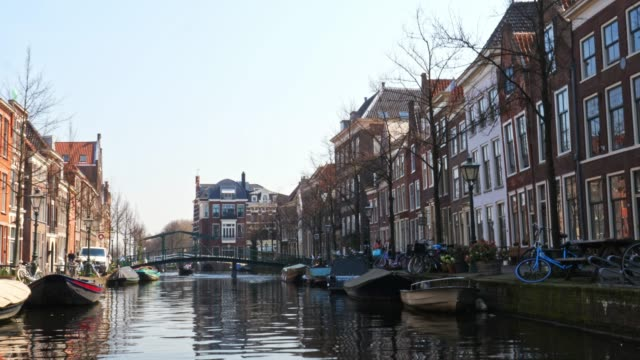 . city of leiden with his canals in early morning sun. - netherlands stock videos & royalty-free footage