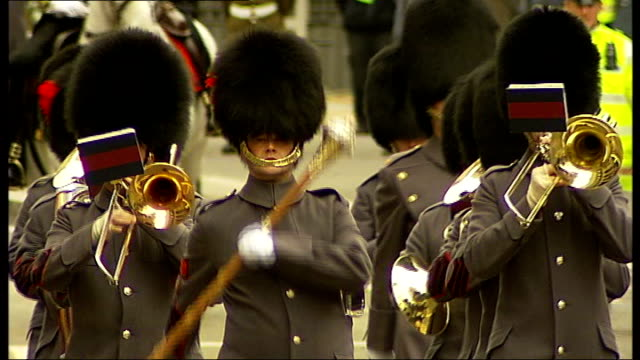 city of london ext **military band music heard over following** military band march along in lord mayor's parade household cavalry guards along in... - lord mayor of london city of london stock videos & royalty-free footage