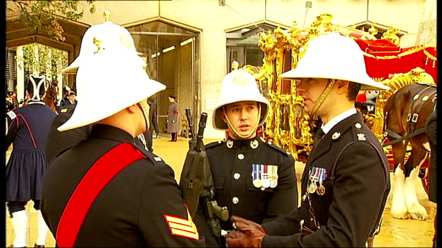 city of london ext soldiers playing bugles ahead of start of lord mayor's show sot soldiers lining up ahead of parade union jack flags over route... - lord mayor of london city of london stock videos & royalty-free footage