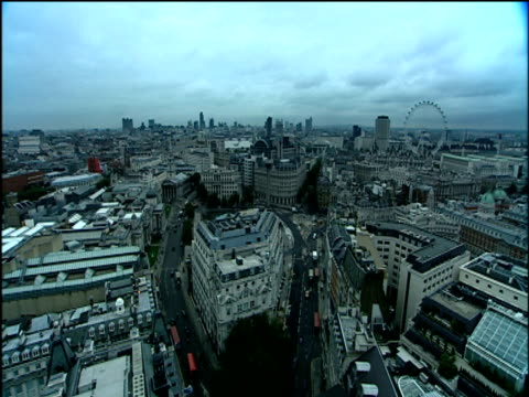city of london with traffic flowing and london eye in background - 1998 stock videos and b-roll footage