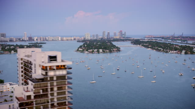 aerial city of miami, fl at sunset - housing difficulties stock videos & royalty-free footage