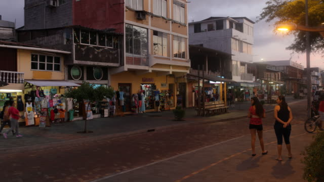 city of san cristã³bal at night with people going for a walk an enjoying the evening, galã¡pagos, ecuador - galapagos islands stock videos & royalty-free footage