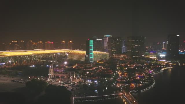 AERIAL City of Suzhou at night with Suzhou International Expo Center, Jiangsu Province, China