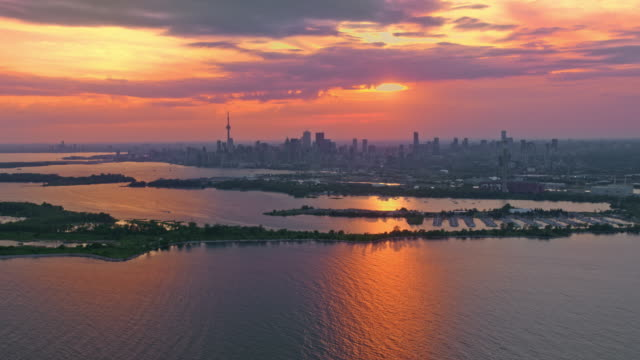 aerial city of toronto with toronto islands at sunset - ontario canada stock videos & royalty-free footage