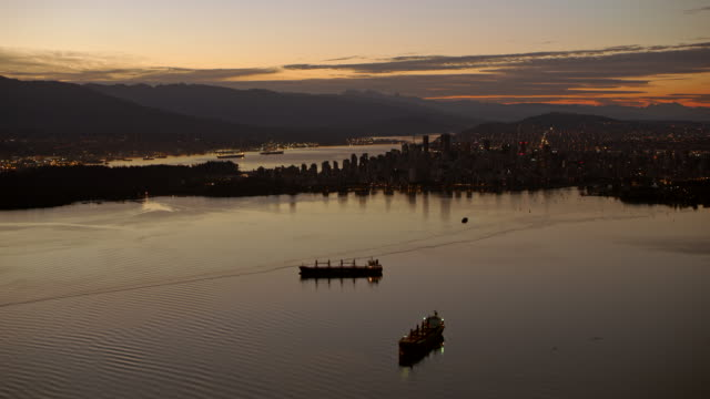 AERIAL City of Vancouver at dusk